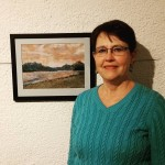 Local artist Kathy Hyer poses with her pastel drawing Yosemitehellip